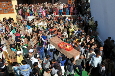 People carrying body of martyr Kultar Singh for cremation at village Gurha Salathia in Samba district on Monday. -Excelsior/Gautam