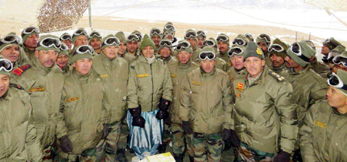 Defence Minister Nirmala Sitharaman with Army personnel in Ladakh on Saturday.