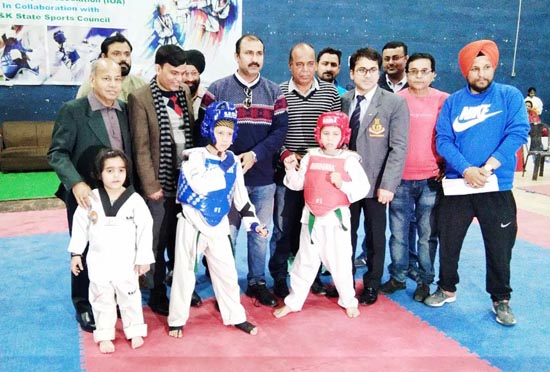 Budding Taekwondo players posing along with Ranjeet Kalra and other dignitaries during opening ceremony of Taekwondo C'ship in Jammu.