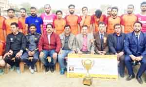 J&K Bank team posing along with dignitaries after lifting Football Tournament in Jammu.