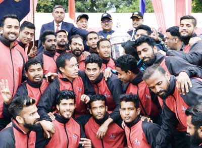 Winners of All Police Football Championship posing for a group photograph along with DyCM, Dr Nirmal Singh in Jammu.