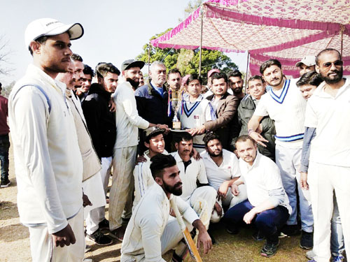 Winners of Cricket Tournament posing along with dignitaries at Billawar on Sunday.