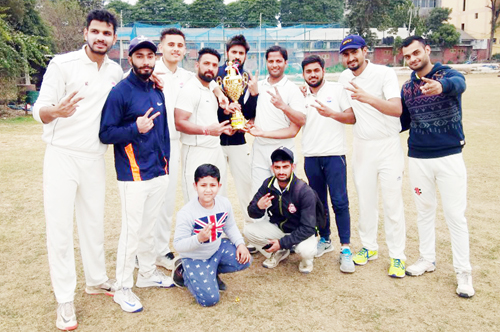 Jubilant players of NCC Jammu posing for a group photograph after lifting T20 title at KCSC in Jammu.