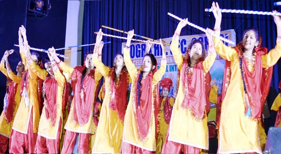 Students presenting colourful cultural item while celebrating Annual Day at Auditorium of Government College for Women Gandhi Nagar in Jammu.