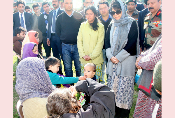 Chief Minister Mehbooba Mufti inter-acting with family members of martyrs at Technical Airport in Jammu on Tuesday.