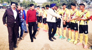 Chief guest interacting with players during a match of 1st Maharaja Hari Singh Memorial gold Cup Football in Jammu.
