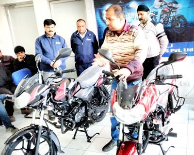 Dignitaries during launch of Discover 110 and 125 models at NSF-Bajaj, Satwari, Jammu on Friday.