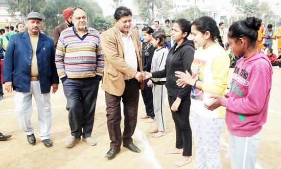 MLA Jammu East Rajesh Gupta interacting with players while inaugurating Kabaddi Tournament in Jammu.