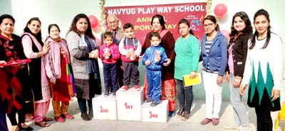 Students receiving prizes during Annual Sports Day at Navyug Play Way School in Jammu.