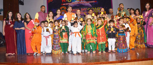 Children posing for photograph after receiving awards on Annual Day.