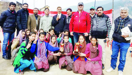 Winners of football event under Khelo India 'Let's Play' posing along with dignitaries at Bhaderwah.