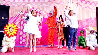 Students presenting colourful activity while celebrating Annual Day at Nehru Public School Mawa Karoda in Akhnoor.