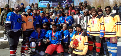 Ice Hockey champions posing for a group photograph along with dignitaries in Drass.