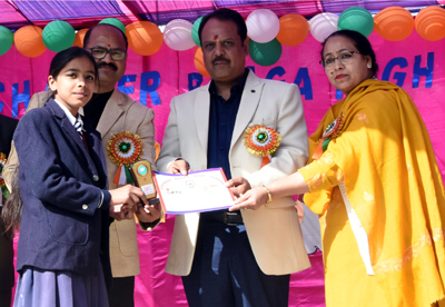 Dignitaries felicitating students during Annual Prize Distribution Function at Chander Bhaga HS in Akhnoor.