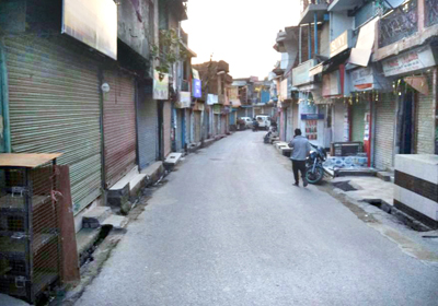 Deserted look of Nowshera town on Friday.