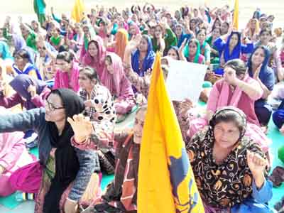 Anganwari workers and helpers during a protest in Samba on Tuesday. -Excelsior/ Gautam