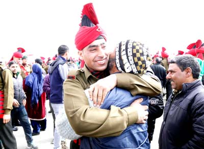 A passout hugs his father at J&K Light Infantry Regiment in Srinagar on Monday. -Excelsior/Shakeel