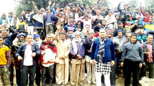 Villagers protesting for completion of Chirdi road in Udhampur.