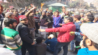 People raising slogans during protest at Thathri in Doda on Monday.