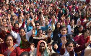 Anganwari workers and helpers staging a protest near Press Club, Jammu. — Excelsior/Rakesh