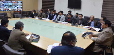 Chief Secretary B B Vyas holding a video conference with DCs at Jammu on Friday.
