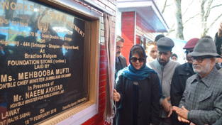Chief Minister Mehbooba Mufti laying foundation stone of a bridge on Sunday.