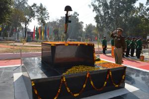 A senior CRPF officer saluting Martyr Memorial at Group Centre, CRPF, Bantalab, Jammu.