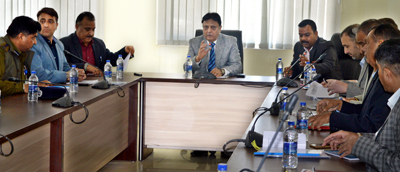 ADGP Munir Khan chairing a meeting at Security Headquarters, Jammu on Saturday.
