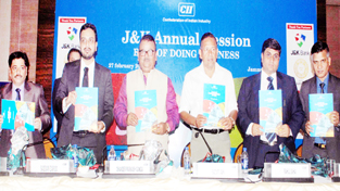 Minister for Industries CP Ganga and others releasing a news-letter on trade and industry during CII annual session in Jammu. -Excelsior/ Rakesh