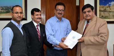 Principal Secretary Finance, Navin Kumar Choudhary submitting report to Chief Secretary BB Vyas at Jammu on Wednesday.