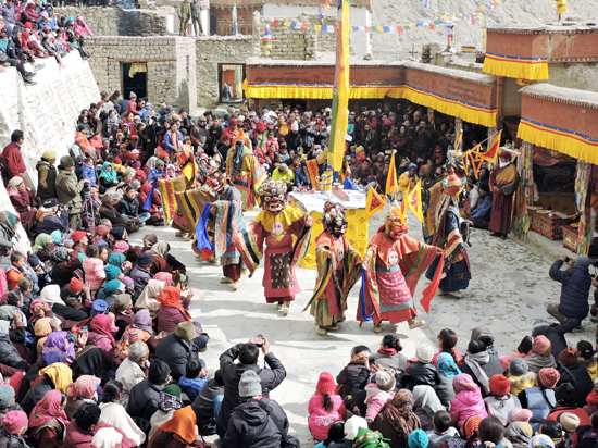 Monks performing mask dance during Mela Dhosmochey in Leh. — Excelsior/Stanzin Morup