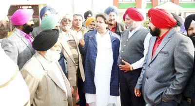 Cong leader Raman Bhalla interacting with people at Gandhi Nagar on Friday.
