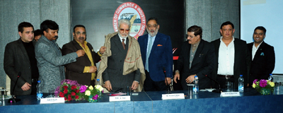 Leading businessman from Dubai, Zaffar Vakil being felicitated by CCI at Jammu on Thursday.