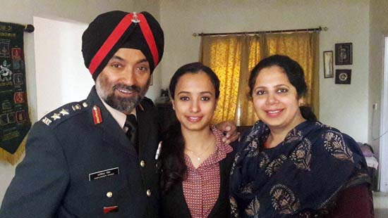 Jammu girl, Ganiv Kaur posing with her parents.
