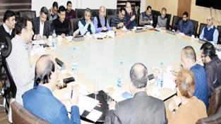 Food Minister Ch Zulfkar chairing a meeting at Jammu on Monday.