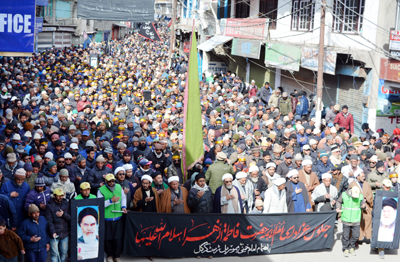 Devotees participating in a religious procession in Kargil on Tuesday.