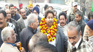 Cong leader Raman Bhalla interacting with people in Jammu on Saturday.