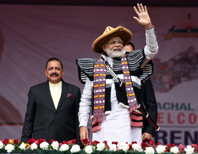 Prime Minister Narendra Modi waiving at the cheering crowd at Itanagar, Arunachal Pradesh on Thursday. Also seen is DoNER Minister Dr Jitendra Singh.
