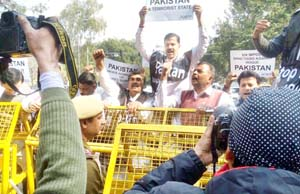JKNPP activists protesting in front of Pak High Commission at New Delhi on Thursday.