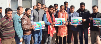 NPP president, Balwant Singh Mankotia and others releasing a bhajan sung by local artist.