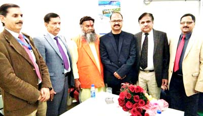 JKGB Chairman, RK Chhibber and others posing after inauguration of new premises of bank's Akhnoor branch.