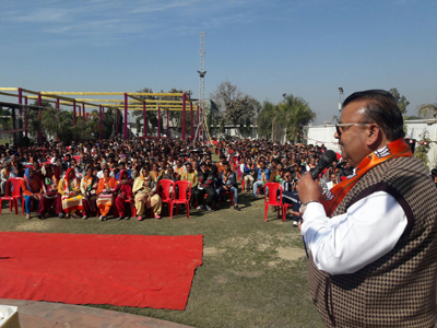 Industries and Commerce Minister, Chander Parkash Ganga addressing BJP workers at Sarore on Sunday. — Excelsior/Gautam