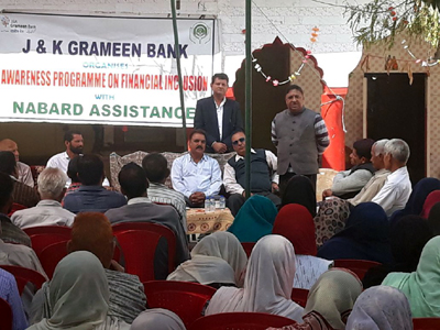 J&K Grameen Bank officials making people aware about digital banking during D-FLAP on Monday.