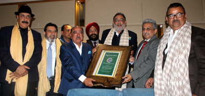 The members of PHD Chamber Commerce and Industry (PHDCCI), J&K Chapter honouring Finance Minister Dr Haseeb A Drabu in a function at Jammu on Thursday.