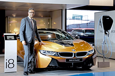 Vikram Pawah, president, BMW Group, with all new BMW i8 Roadster.