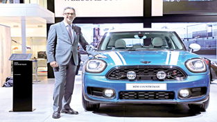 Vikram Pawah, president, BMW Group India, posing with all-new MINI Countryman.