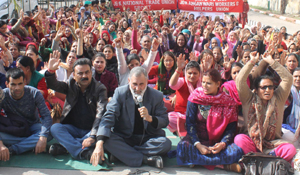 Anganwari workers and helpers protesting in support of their demands at Jammu on Friday. — Excelsior/Rakesh