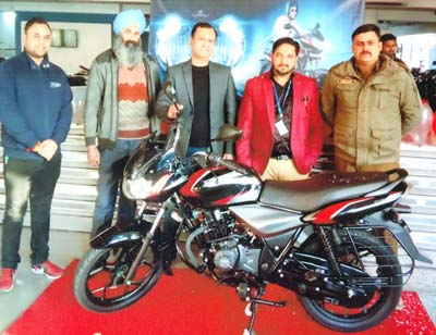 Vineet Aggarwal, Director, Jammu Motors, along with other officials during the launch of all-new Discover 110.