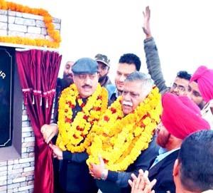 Haq lays foundation stone  of Rurban cluster village