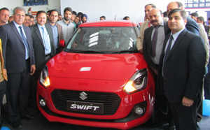 Sunil Gupta, vice president and Zonal Head Jammu Central-I, J&K Bank, along with Col Rattan Singh (Retd) COO and ED, Jamkash Vehicleades, unveiling 3rd generation of Maruti Suzuki's Swift.